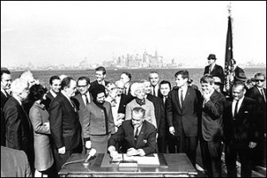 President Lyndon B. Johnson signs the Immigration Reform Act on Liberty Island. LBJ Library and Museum.