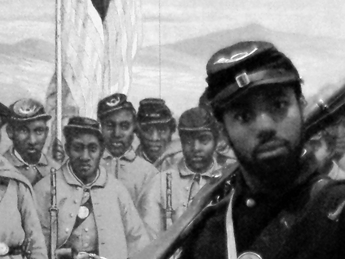 Marquett Milton, aka the Soldier of U Street, poses in his Union uniform in front of an exhibit at the African American Civil War Museum.