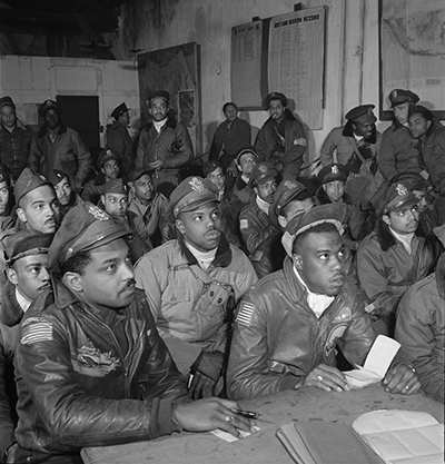 An image of members of the Army Air Force 332nd Fighter Group in a briefing room, Ramitelli, Italy. March 1945. Source: Library of Congress