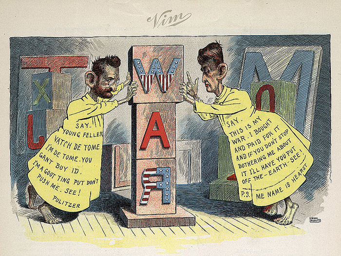 "A photo of ""The big type war of the yellow kids"" by Leon Barritt. Published in Vim, June 29, 1898. Joseph Pulitzer and William Randolph Hearst, full-length, dressed as the Yellow Kid, each pushing against opposite sides of a pillar of wooden blocks that spells WAR. Source: Library of Congress"