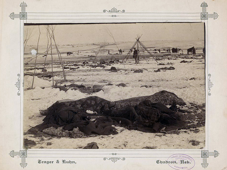 Big Foot's camp three weeks after the Wounded Knee Massacre (Dec. 29, 1890), with bodies of several Lakota Sioux people wrapped in blankets in the foreground and U.S. soldiers in the background. Source: Library of Congress