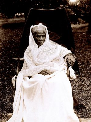An image of Harriet Tubman, full-length portrait, seated in chair, facing front, probably at her home in Auburn, New York, 1911. Source: Library of Congress