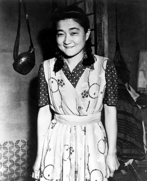 An image of the woman behind the voice and program that lightened the weary hours of many a G.I., Tokyo Rose. Her real name is Iva Toguri D\'Aquino. She was born in Los Angeles, but claims to be Portugese by marriage. This includes a duplicate photo and negative. From: A scrapbook presented to Postmaster General Robert E. Hannegan on the occasion of his visit to General Headquarters, U.S.Army Forces, Pacific, in Tokyo, Japan, July, 1946. Credit: Harry S. Truman Library & Museum.