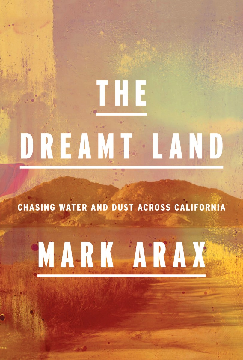 "The cover of ""The Dreamt Land"" depicting an orange-hued, arid landscape."
