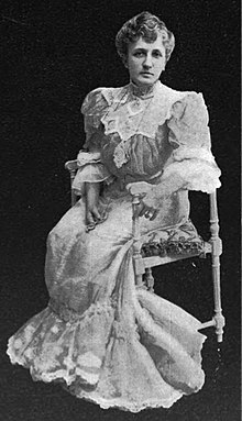 Full-length portrait of Helen Hamilton Gardener, seated.